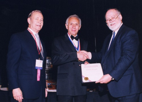 "Alexander A. Nikolsky Honorary Lectureship Award presented to Santino Pancotti, Vice President, Advanced Design, Agusta Westland, at annual Forum 59 Awards, 2003. his lecture entitled,""After 50 years of Helicopter Design Are Rotorcraft Mature Enough For the Commuter Roll?"" Andy Kerr (right) AHS Technical Director and Dr. Robert G. Lowey congratulated him.  Forum 59, May 6-8, 2003, Phoenix, Arizona USA"
