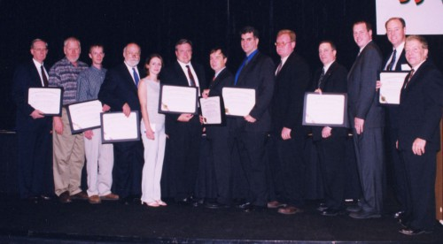 Robert L. Pinckney Award 2003 presented to NRTC/RITA Bell-Sikorsky High-Speed Machining of Titanium Team at annual Forum 59 Awards. The representatives of the team were- Edmund Leigh, Stephen Varansy, William Harris, Paul Darcy, Thomas S. Delio, John Schueller, Scott Smith, Bethany Wood, Andy Kerr, Glenn Bushendrof and Rande Vause - all congratulated by Gilles Ouimet.  Forum 59, May 6-8, 2003, Phoenix, Arizona USA