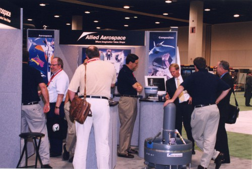 Annual Forum 59, 2003 and photo showing visitors at Exhibit Hall 2 at display stall of Allied Aerospace.  Forum 59, May 6-8, 2003 Phoenix, Arizona USA