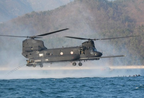 Crew members throw a rope ladder out the back of a U.S. Army MH-47 helicopter from the 160th Special Operations Aviation Regiment (Airborne) to retrieve members of the 320th Special Tactics Squadron from the water during an infiltration/exfiltration training mission March 20 during Foal Eagle 2009. Foal Eagle is an annual combined training exercise for U.S. and Republic of Korea forces to evaluate and improve their ability to coordinate procedures, plans and systems necessary to defend the ROK. The 320th STS is deployed from Kadena Air Base, Japan, and the 160th SOAR is deployed from Fort Lewis, Wash. (U.S. Air Force photo by James D'Angina)