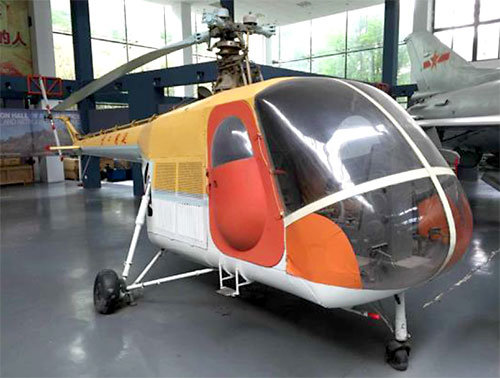 Development of the Yan'an-2, China's first domestic helicopter, was initially started by students and faculty at Northwest Polytechnic University in 1958. Design work was transferred to the Nanjing Aviation Institute (now Nanjing University of Aeronautics and Astronautics) in 1965.  A two-seater light helicopter, the Yan'an-2 fuselage was a semi-monocoque pod-and-boom construction on tricycle landing gear. Two prototypes and a static test article were made. Although the helicopter never reached mass production, a variant was developed in 1983 in which the main rotor material was changed from metal to composite. An example is on display at the NUAA Aviation Museum.  Photo 2016 by Jacques Virasak.