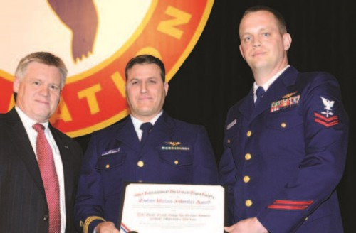 The Captain William J. Kossler, USCG Award won by worthy HH-60J Jayhawk Air Station Astoria (Oregon) Team at Forum 64 awards, 2008, for their life saving efforts during the great coastal gale of 2007.  Mr. Dunford (left) congratulates Lt. Eric Smith, the aircraft co-pilot and Chief Petty Officer Adam Mayhugh for their heroic efforts.  Forum 64, April 29-May 1, 2008, Montréal, Québec Canada