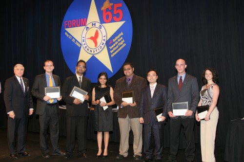 Vertical Flight Foundation Scholarships in 2009 at annual Forum 65 were distributed to worthy students.  Charles W. Hughes, Jr., AHS Technical Director recognizes the VFF winners able to attend the AHS banquet including Jessica Newman, Stanton Sollenberger, Seongkyu Lee, Mihir Mistry, Monica Syal, Chandrashekhar Tiwari and Benjamin King Sutton Woods.  Other VFF Scholarship winners included Axel Schauenburg, William Kong, Bethany Davis, Louis Aminata Ahure, Kevin Lee Rankin, and Kelly Cheng.  Forum 65, May 27-29, 2009 Grapevine, Texas USA