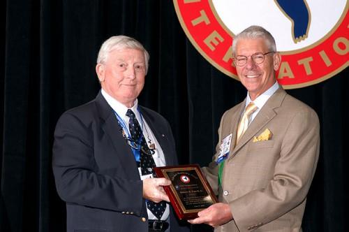 The Individual Sponsor Award at Forum 60, 2004, awarded to Robert Powell (left), the Hampton Roads Chapter Treasurer.  M.E. Rhett Flater, Executive Director congratulates Mr. Robert Powell.  Forum 60, June 7-10, 2004, Baltimore, Maryland USA
