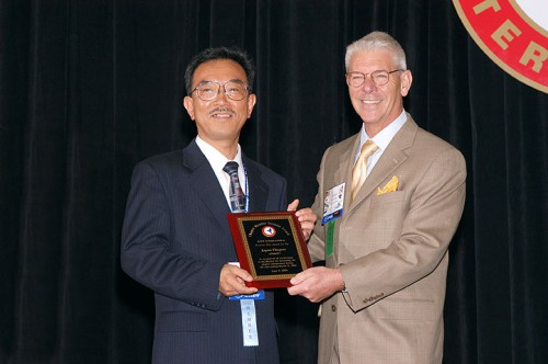 Greatest Net Increase Membership Contest at Forum 60, 2004, won by AHS Japan Chapter and is accepted by Mr. Junji Takaki, President of the AHS Japan Chapter.  Mr. Rhett Flater presenting the award (right) to Mr. Junji Takaki.  Forum 60, June 7-10, 2004, Baltimore, Maryland USA