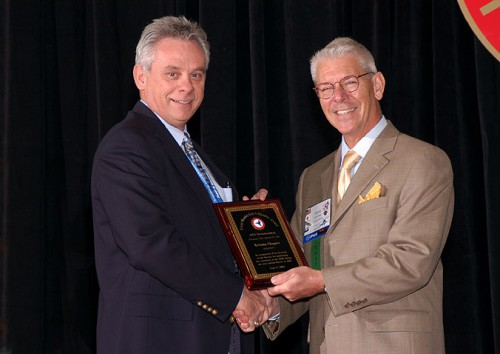 Every-Member-Get-a-Member Award at annual Forum 60, 2004, won by AHS Arizona Chapter with the greatest percentage of members who sponsored a new member during the past year.  Harry Harr (left), president of the Arizona Chapter, accepts the award from Mr. Rhett Flater (right).  Forum 60, June 7-10, 2004, Baltimore, Maryland USA