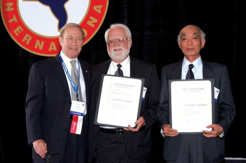 Honorary Fellowships at annual Forum 60 Awards, 2004 presented to Dr. Tomoari Nagashima (right), Professor Emeritus, National Defense Academy, and Cecil Richardson (center), Lockheed Martin Corporation (Ret.), by Dr. Robert G. Loewy (left), Society Chairman.  Forum 60, June 7-10, 2004, Baltimore, Maryland USA