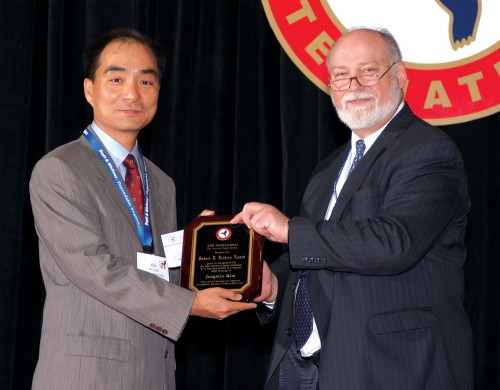 "The Robert L. Lichten Award 2004 at Forum 60 awards presented to Jongmin Kim, for his paper ""Flow Control Strategies for Improved Aerodynamic Efficiency of Micro-Rotorcraft,"" by Mr. Andrew Kerr, Director, US Army AFDD and Director, NRTC, US Army and Former AHS Technical Council Director.  Forum 60, June 7-10, 2004, Baltimore, Maryland USA"