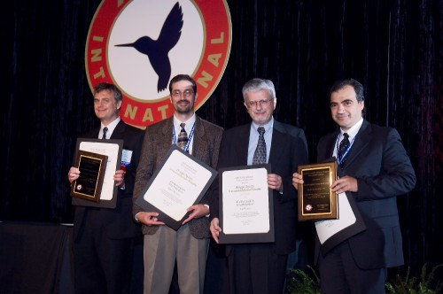 The Gruppo Agusta International Helicopter Fellowship 2006 at annual Forum 62 Awards presented to the Boeing/CIRA (Italian Aerospace Research Center) Icing Study Team - represented from left to right by Peter Hartman, Robert Narducci, and Leo Dadone from Boeing Philadelphia, and Giuseppe Mingione, of CIRA - are commended for significantly advancing the process and procedures for icing prediction using state-of-the-art CFD codes.  Forum 62, May 9-11, 2006, Phoenix, Arizona USA