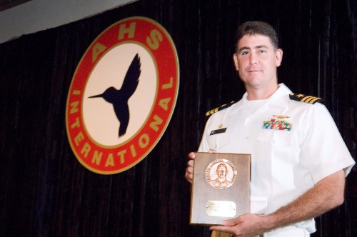 The Frederick L. Feinberg Award 2006 at Forum 62 won by Navy Helicopter Squadron HM-15 Black Hawks.  Navy Commander George Parisi accepts the award from Dr. Forster on behalf of the crew who supported tsunami devastated victims in Indonesia.  Forum 62, May 9-11, 2006, Phoenix, Arizona USA