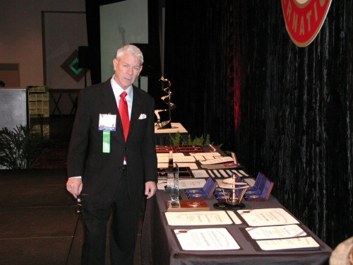M.E. Rhett Flater with final arrangement of prestigious awards for distribution at annual Forum 62 Awards ceremony in 2006.  Forum 62, May 9-11, 2006, Phoenix, Arizona USA