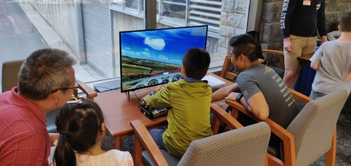 The children were able to fly fixed wing aircraft using the X-Plane Simulator software and a joystick.