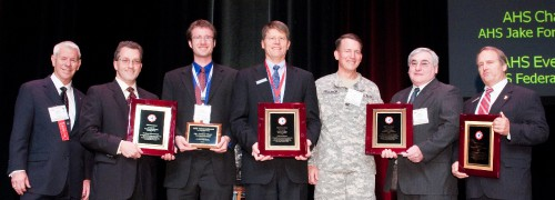 AHS Membership Contest winners at annual Forum 66 Awards, 2010. The AHS Individual Sponsor Award won by Dr. Ed Smith, The Pennsylvania State University.  Mr. Conor Marr, also received recognition for his work in expanding the student chapter at the Pennsylvania State University.  AHS Member Percent Increase Contest won by AHS Jake Fortner Chapter, represented by COL Joseph Jellison.  The AHS Chapter Member Increase Contest awarded to AHS Southwest Chapter, represented by Mr. John Garrison, president and CEO of Bell Helicopter Textron, Inc.  The Every-Member-Get-A-Member Contest award accepted by Mr. David Wildes, Chapter Program Director, AHS Federal City Chapter.   Mr. Rhett Flater (left), AHS Executive Director (left to right) congratulates Dr. Smith, Mr. Marr, Mr. Garrison, COL Jellison, Mr. Harrison and Mr. Wildes for their dedicated efforts to increase membership in the Society.  Forum 66, May 11-13, 2010, Phoenix, Arizona USA