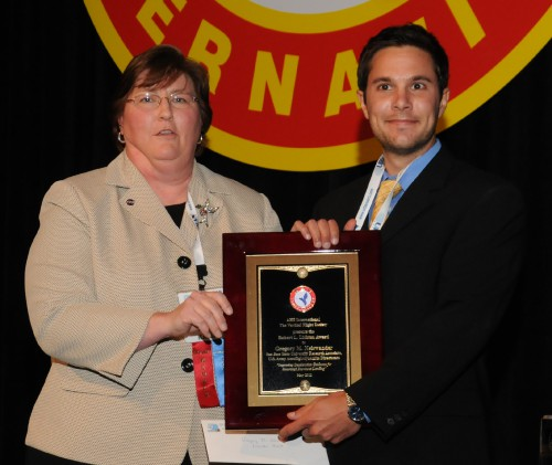 """Robert L. Lichten Award 2011 at annual Forum 67 awarded to Mr. Gregory N. Neiswander, a research associate from the San Jose Research Foundation working with US Army Aeroflighdynamics Directorate, for his paper titled, """"Improving Deceleration Guidance for Rotorcraft Brownout Landings.""""  AHS Technical Director, Susan A. Gorton, NASA Langley Research Center (left), congratulates Mr. Neiswander in the picture.  Forum 67, May 3-5, 2011, Virginia Beach, Virginia USA"""
