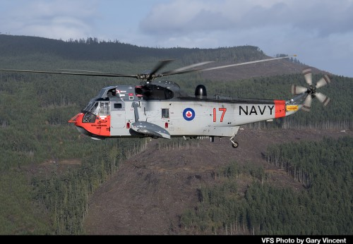 "Sikorsky CH-124B tail number 12417 of the Royal Canadian Air Force flies over Victoria Island on Nov 27, 2018 in conjunction with the RCAF Sea King retirement ceremony. This aircraft was repainted in 1960s Royal Canadian Navy colors (as 4017) which were the markings carried by Sea Kings prior to the unification of the Canadian Forces in 1968. For more on the history of the Canadian Sea King and the retirement, see ""A Royal Send Off for the Canadian Sea King,"" Vertiflite, Jan/Feb 2019. (VFS Photo by Gary Vincent. CC-BY-SA 4.0)"
