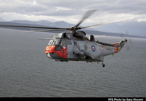 """Sikorsky CH-124B tail number 12417 of the Royal Canadian Air Force flies over he southern Vancouver Island region on Nov 27, 2018 in conjunction with the RCAF Sea King retirement ceremony. This aircraft was repainted in 1960s Royal Canadian Navy colors (as 4017) which were the markings carried by Sea Kings prior to the unification of the Canadian Forces in 1968. For more on the history of the Canadian Sea King and the retirement, see """"A Royal Send Off for the Canadian Sea King,"""" Vertiflite, Jan/Feb 2019. (VFS Photo by Gary Vincent. CC-BY-SA 4.0)"""
