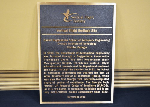 Georgia Tech was awarded the VFS Vertical Flight Heritage Site award, with the plaque unveiling ceremony held on Nov. 28, 2018. The ceremony to unveil the 35 lb (16 kg) forged-bronze plaque was held as part of a Vertical Lift Heritage Reception at the school's Alumni House, in conjunction with Georgia Tech's annual VLRCOE review. Accolades and comments were provided by VFS President (and Bell vice-president) Glenn Isbell, GT Executive Vice-President of Research Chaouki T. Abdallah, and GT Aerospace Engineering Chair Dr. Mark Costello. VFS Executive Director Mike Hirschberg and Dr. Costello then formally unveiled the plaque and presented it to the school. (Georgia Tech photo. Used with permission.)