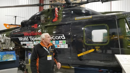 "Museum guide explaining the history of the world record-holder for fastest helicopter, the ""G-LYNX"" Westland Lynx Series 1 with BERP rotor blades. VFS photo taken at the Helicopter Museum, Weston-super-Mare, UK, Nov. 15, 2018. (CC-BY-SA 4.0)"