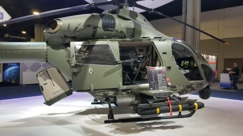 "MD Helicopters unveiled its MD 969 Combat Explorer — a derivative of its MD 902 Explorer — which would serve as a testbed for its advanced ""Swift"" rotorcraft for the US Army's Future Attack Reconnaissance Aircraft (FARA) competition. Shown here is the 7.62 mm door-mounted Gatling-gun and a view inside the cabin. (VFS photo taken on March 7, 2019. CC-BY-SA 4.0)"