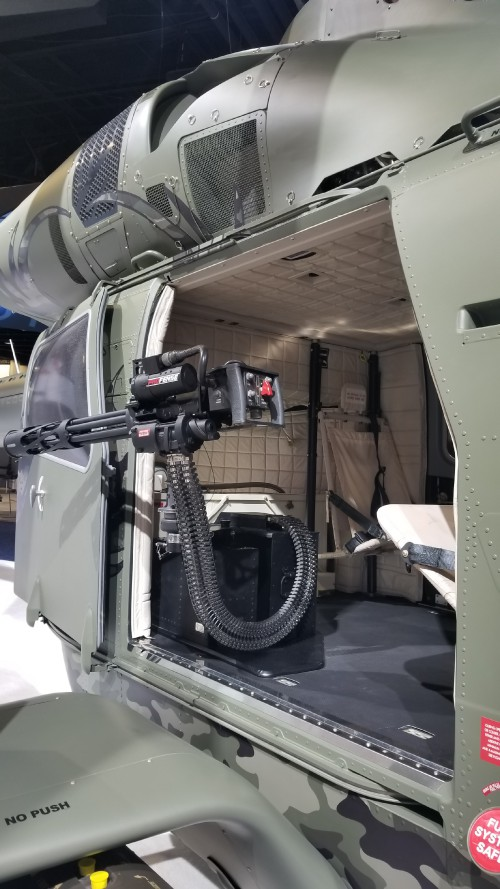 """MD Helicopters unveiled its MD 969 Combat Explorer — a derivative of its MD 902 Explorer — which would serve as a testbed for its advanced """"Swift"""" rotorcraft for the US Army's Future Attack Reconnaissance Aircraft (FARA) competition. Shown here is the 7.62 mm door-mounted Gatling-gun and a view inside the cabin. (VFS photo taken on March 7, 2019. CC-BY-SA 4.0)"""