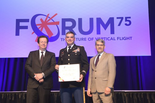 Capt William J Kossler Award, CW4 Donald J Ford with R. Garavaglia & M. Hirschberg during the Forum 75 Grand Awards Banquet, Wednesday evening, May 15, 2019. (VFS photo by Kenneth I. Swartz. CC-BY-SA 4.0)