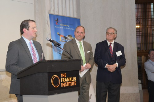 Neil Weaver, PA Governor's Office at the Memoirs of our Pioneers reception at the Franklin Institute, Monday evening, May 13, 2019. Weaver is the Executive Deputy Secretary Department of Community and Economic Development for the Commonwealth of Pennsylvania. Next to him is John Piasecki, CEO of Piasecki Aircraft Corp. and the main sponsor for the reception, as well as Bob Torgerson, Piasecki Aircraft Corp, the VFS organizer for the Governor's Office. (VFS photo by Kenneth I. Swartz. CC-BY-SA 4.0)