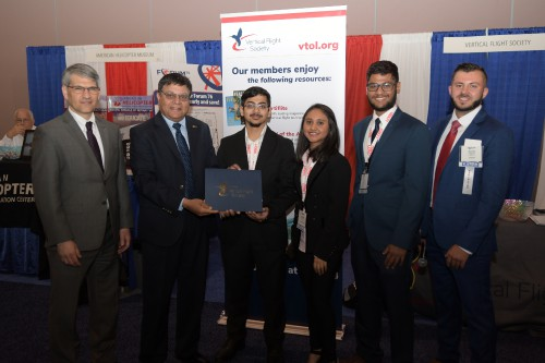 Ajay Sehgal, Mike Hirschberg and George Farah, present the 2nd place awards for the 7th Annual Micro Air Vehicle (MAV) Student Challenge to Vaughn College of Aeronautics & Technology on Tuesday, May 14, 2019 at Forum 75. (VFS Photo by Kenneth I. Swartz. CC-BY-SA 4.0)