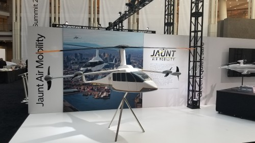25%-scale model of Jaunt Air Mobility's reduced rotor operating speed aircraft (ROSA) eVTOL concept displayed at Uber Elevate Summit 2019. Uber held its third annual summit on June 11-12 at the Ronald Reagan Building and International Trade Center in Washington, DC. (VFS staff photo taken June 11, 2019. CC-BY-SA 4.0)