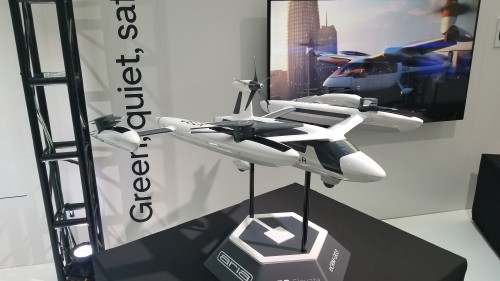 Model of Uber's eCRM-003 eVTOL concept displayed at Uber Elevate Summit 2019. Uber held its third annual summit on June 11-12 at the Ronald Reagan Building and International Trade Center in Washington, DC. (VFS staff photo taken June 11, 2019. CC-BY-SA 4.0)