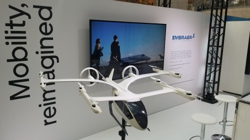 Model of the EmbraerX DreamMaker eVTOL aircraft concept unveiled at Uber Elevate Summit 2019. Uber held its third annual summit on June 11-12 at the Ronald Reagan Building and International Trade Center in Washington, DC. (VFS staff photo taken June 11, 2019. CC-BY-SA 4.0)