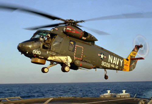 A left front view of a Helicopter Light Anti-submarine Squadron 30 (HSL-30) SH-2F Sea Sprite helicopter preparing to land on the helicopter pad of the destroyer USS NICHOLSON (DD-982).