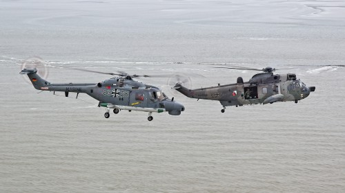 "The Westland Sea King (right), in service since 1975, and the Westland Lynx Mk 88A (left), since 1981, have been the mainstay of the German Marineflieger. The two operational helicopters form the air assets of MFG 5. These photos of Marinefliegergeschwader (MFG) 5 in action accompany the article ""German Navy Helicopter Fleet Still Going Strong,"" by Anno Gravemaker, in the Vertiflite Sep/Oct issue. Photo taken June 19, 2019 by Anno Gravemaker CC BY-NC-SA 4.0."