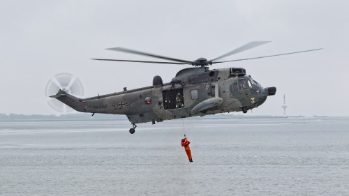"A Sea King rescues a downed crewman during a SAR exercise. The mighty Sea King has been saving lives along the German coastline for over 40 years. It will soon be replaced in that role by the NH90. These photos of Marinefliegergeschwader (MFG) 5 in action accompany the article ""German Navy Helicopter Fleet Still Going Strong,"" by Anno Gravemaker, in the Vertiflite Sep/Oct issue. Photo taken June 19, 2019 by Anno Gravemaker CC BY-NC-SA 4.0."