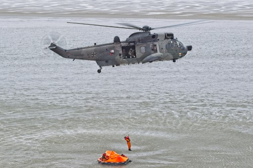 "A Sea King picking up a downed crewman during a SAR exercise. The mighty Sea King has been saving lives along the German coastline for over 40 years. It will soon be replaced in that role by the NH90. These photos of Marinefliegergeschwader (MFG) 5 in action accompany the article ""German Navy Helicopter Fleet Still Going Strong,"" by Anno Gravemaker, in the Vertiflite Sep/Oct issue. Photo taken June 19, 2019 by Anno Gravemaker CC BY-NC-SA 4.0."