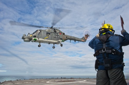 """German Naval Aviation Wing MFG 5 Sea Lynx landing (note the nose art). These photos of Marinefliegergeschwader (MFG) 5 in action accompany the article """"German Navy Helicopter Fleet Still Going Strong,"""" by Anno Gravemaker, in the Vertiflite Sep/Oct issue. Photo taken June 19, 2019 by Anno Gravemaker CC BY-NC-SA 4.0."""