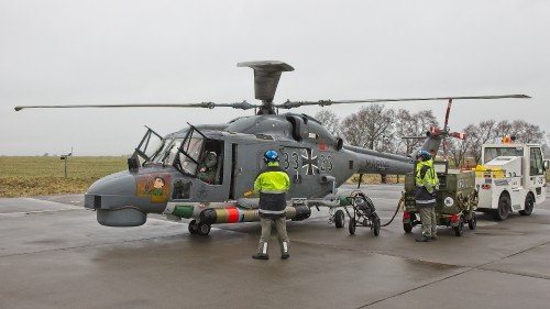 "The Marineflieger ground crew mounting the EuroTorp MU90 torpedo on a Sea Lynx. These photos of Marinefliegergeschwader (MFG) 5 in action accompany the article ""German Navy Helicopter Fleet Still Going Strong,"" by Anno Gravemaker, in the Vertiflite Sep/Oct issue. Photo taken June 19, 2019 by Anno Gravemaker CC BY-NC-SA 4.0."