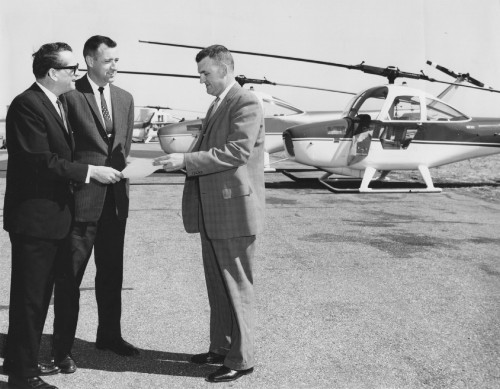 WICHITA, KANSAS-- The Federal Aviation Agency officially approved Cessna Aircraft Company's rotary-wing flight training school this week. Theo 0. Moore, right, FAA General Aviation Operations Inspector, is shown presenting the flight school certificate to Dr. Robert McCormick, Cessna Director of Training, and Edward MacKenzie, Head of Rotary-wing Flight Instruction. The Cessna school is one of 20 approved rotary-wing training facilities in the nation. The school was established to train flight and service personnel for Cessna's new rotary-wing Skyhook shown in the background.  Cessna Aircraft Company News Bureau photo. From Vertiflite (AHS Newsletter) May 1962.