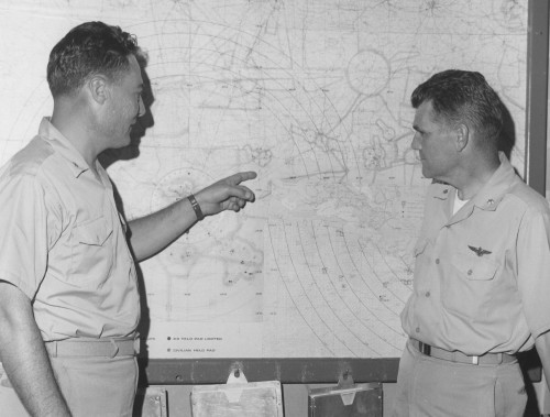 FOR IMMEDIATE RELEASE  NEW ORLEANS -- Comdr. George F. Thometz (left), head of Coast Guard Air Station at Callender Field, and Lt. Comdr. John Redfield, his executive officer, pinpoint flood-damaged areas on wall map.   Sikorsky Aircraft photo. November 2, 1965