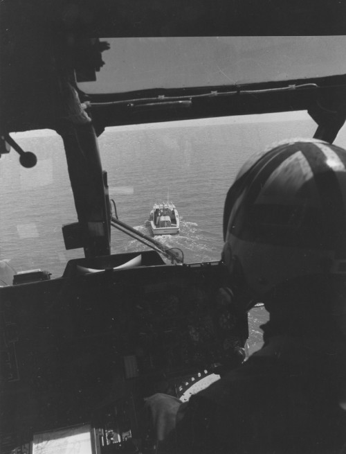 """FOR IMMEDIATE RELEASE  Call comes -- and HH-3F heads for Lake Pontchartrain north of New Orleans where crewman on small boat has been """"injured."""" This was a simulated rescue mission.  July 2, 1969  Sikorsky Aircraft photo"""