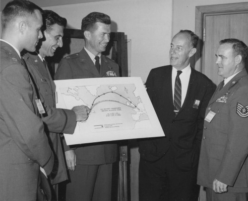 In Sikorsky conference room crewmen discuss nonstop flight with Lee S. Johnson, Sikorsky division president. Left to right, Captain Buckley, Major Zehnder, Capt. Alford, Mr. Johnson and Sgt. Schrader.