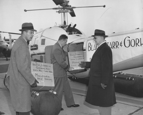 New York Airways  Black, Starr & Gorham Christmas helicopter deliveries from W. 30th St. heliport. Left to right: M.H. Goode, Captain John Mahoney, Alfred Smith, pres. of B S & G.  New York Airways photo