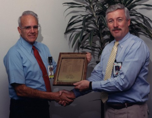 Robert E. Head (left) receives a plaque with his first patent from Hughes Helicopters executive Dean Borgman.  Head was a valuable contributor on many projects and helicopter models. He retired as a Senior Research and Engineering Fellow and was widely respected and admired. In addition to all his other positive attributes he was one of the best mentors of young engineers.