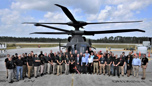 Grover E. Bell Award recipient at VFS annual Forum 76, October 5-8, 2020 (Virtual), is the Sikorsky-Boeing/Army Joint Multi-Role Test Team (some of whom are seen here).  Over the past two years, the JMR Test Team completed powered wind tunnel testing of a one-fifth scale SB>1 Defiant in the National Full-scale Aerodynamics Complex (NFAC) wind tunnel, Propulsion System Test Bed (PSTB) endurance testing of key SB>1 drivetrain components, and flight testing of the Defiant aircraft. The data collected provide a comprehensive database for the SB>1 aircraft that has been instrumental in informing the US Army's decisions for Future Vertical Lift (FVL).